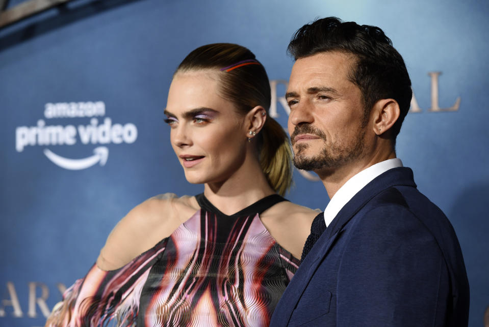 """Cara Delevingne, left, and Orlando Bloom, cast members in the Amazon Prime Video series """"Carnival Row,"""" pose together at the premiere of the series at the TCL Chinese Theatre, Wednesday, Aug. 21, 2019, in Los Angeles. (Photo by Chris Pizzello/Invision/AP)"""