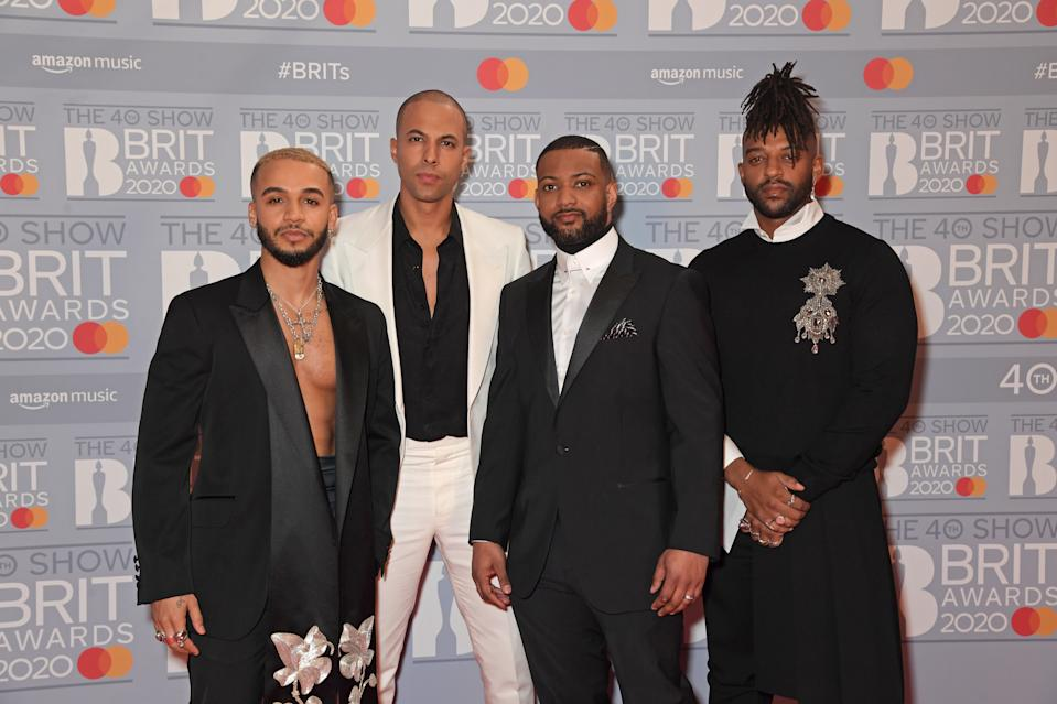 JLS have opted for a gothic makeover at this year's event and we're loving it, particularly Aston Merrygold's flower embroidered lapels. (Getty Images)
