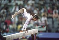 <p>Part of the bronze-medal-winning USA team, Dominique Dawes defied gravity on the balance beam. </p>