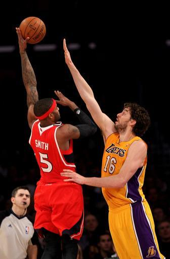 LOS ANGELES, CA - FEBRUARY 14: Josh Smith #5 of the Atlanta Hawks shoots over Pau Gasol #16 of the Los Angeles Lakers at Staples Center on February 14, 2012 in Los Angeles, California. (Photo by Stephen Dunn/Getty Images)