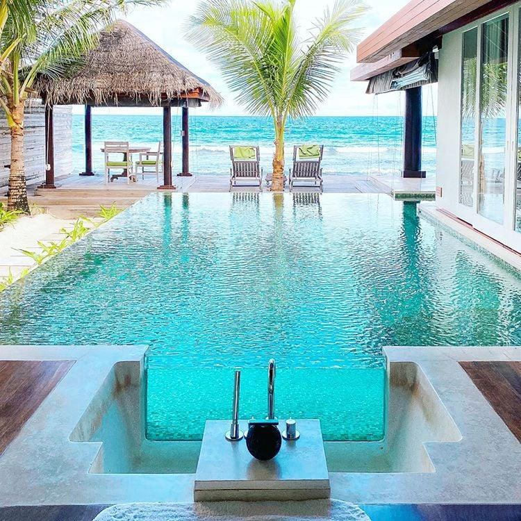 "<p>One of the most secluded and intimate resorts in the Maldives is <a href=""http://www.anantara.com/en/naladhu-maldives/rooms"" class=""link rapid-noclick-resp"" rel=""nofollow noopener"" target=""_blank"" data-ylk=""slk:Naladhu Private Island"">Naladhu Private Island</a>, which only holds 20 villas total. It's truly one-of-a-kind and exudes the true meaning of luxury. Here, there's no set menu because the chef will cook up anything you're craving, whether it's a wagyu beef burger, tuna tartare, or a fresh Maldivian catch of the day. And the best part is breakfast is served 24/7! So yes, you can eat waffles at midnight in your villa if you want to (because who doesn't?). </p> <p>Guests also have access to the nearby sister hotels <a href=""http://www.anantara.com/en/dhigu-maldives"" class=""link rapid-noclick-resp"" rel=""nofollow noopener"" target=""_blank"" data-ylk=""slk:Anantara Dhigu"">Anantara Dhigu</a> and <a href=""http://www.anantara.com/en/veli-maldives"" class=""link rapid-noclick-resp"" rel=""nofollow noopener"" target=""_blank"" data-ylk=""slk:Anantara Veli"">Anantara Veli</a>, but those hotel's guests do not have access to Naladhu. The villas are elevated right over the ocean so you can fall asleep hearing the waves crash or soak in the bathtub that connects to a private infinity pool overlooking the sea. <a href=""http://www.anantara.com/en/naladhu-maldives/restaurants/the-living-room"" class=""link rapid-noclick-resp"" rel=""nofollow noopener"" target=""_blank"" data-ylk=""slk:The Living Room"">The Living Room</a> is the hotel's beachfront restaurant where you can dine for breakfast, lunch, and dinner. Overall, it's great for all types of travelers who are looking for more remote and peaceful island vibes.</p>"