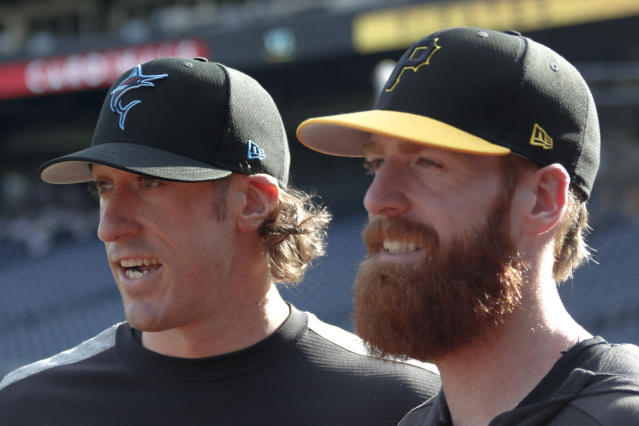 Brothers Brian Moran (left) and Colin Moran (right) made MLB history. (AP Photo/Keith Srakocic)