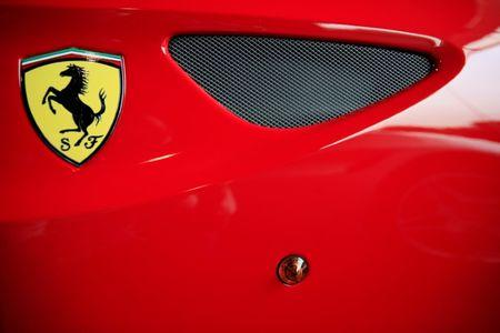 FILE PHOTO: The Ferrari logo on a car at a dealership in Singapore