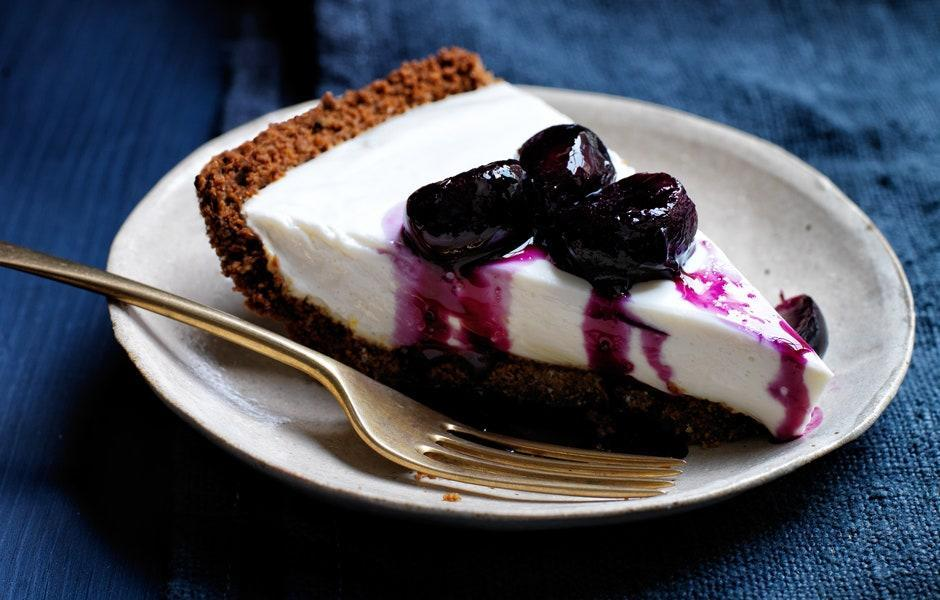 """We tried all kinds of gingersnaps to make this easy crust. Our favorite? Anna's Ginger Thins. <a href=""""https://www.bonappetit.com/recipe/yogurt-pie-with-grape-and-black-pepper-compote?mbid=synd_yahoo_rss"""" rel=""""nofollow noopener"""" target=""""_blank"""" data-ylk=""""slk:See recipe."""" class=""""link rapid-noclick-resp"""">See recipe.</a>"""
