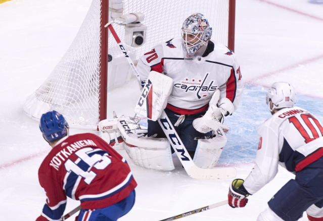 Montreal Canadiens' Jesperi Kotkaniemi scores past Washington Capitals goaltender Braden Holtby as Capitals' Brett Connolly looks on during first period NHL hockey action in Montreal on Thursday, Nov. 1, 2018. (Paul Chiasson/The Canadian Press via AP)