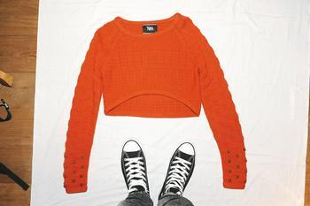orange knit with skull studd top $3,699