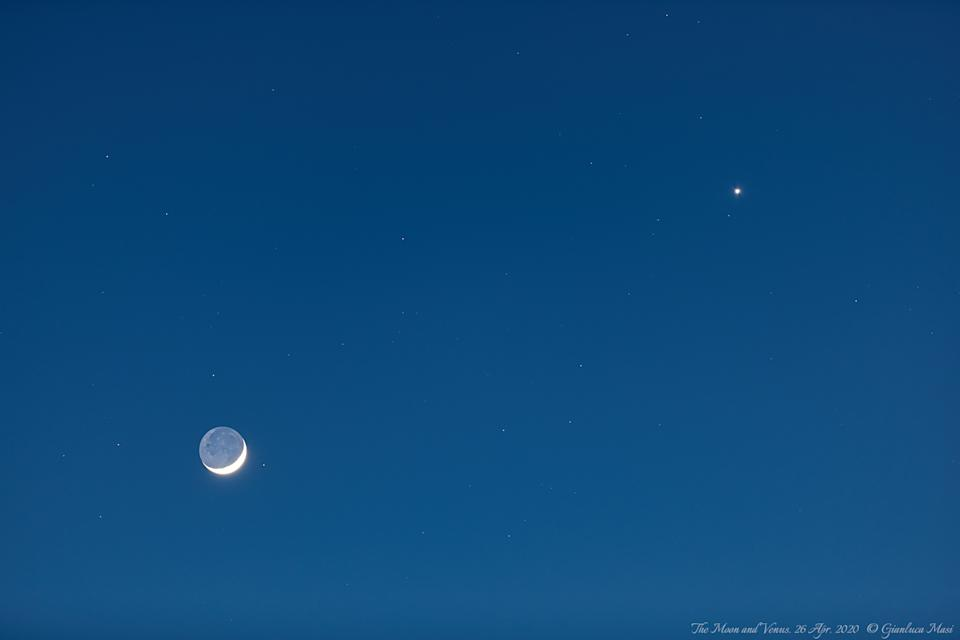 "The bright ""evening star"" Venus shines near the crescent moon in this photo captured by astrophysicist Gianluca Masi of the Virtual Telescope Project. Venus and the moon made a close approach in the evening sky yesterday (April 26), and the planet will reach its greatest brightness of the year tomorrow (April 28)."