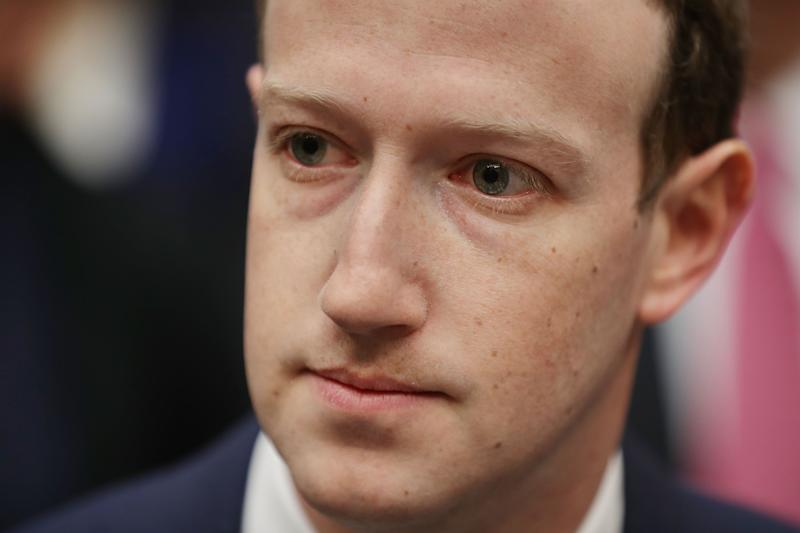 WASHINGTON, DC - APRIL 11:  Facebook co-founder, Chairman and CEO Mark Zuckerberg prepares to testify before the House Energy and Commerce Committee in the Rayburn House Office Building on Capitol Hill April 11, 2018 in Washington, DC. This is the second day of testimony before Congress by Zuckerberg, 33, after it was reported that 87 million Facebook users had their personal information harvested by Cambridge Analytica, a British political consulting firm linked to the Trump campaign.  (Photo by Chip Somodevilla/Getty Images)