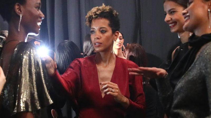 Carly Cushnie, center, prepares models backstage at the Cushnie show during NY Fashion Week on February 8, 2019, in New York City.