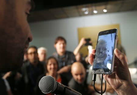 """71st Cannes Film Festival - News conference for film """"The Picture Book"""" (Le livre d'image) in competition - Cannes, France May 12, 2018. Director Jean-Luc Godard is seen on a screen as he replies to a journalist via video conference. REUTERS/Regis Duvignau"""