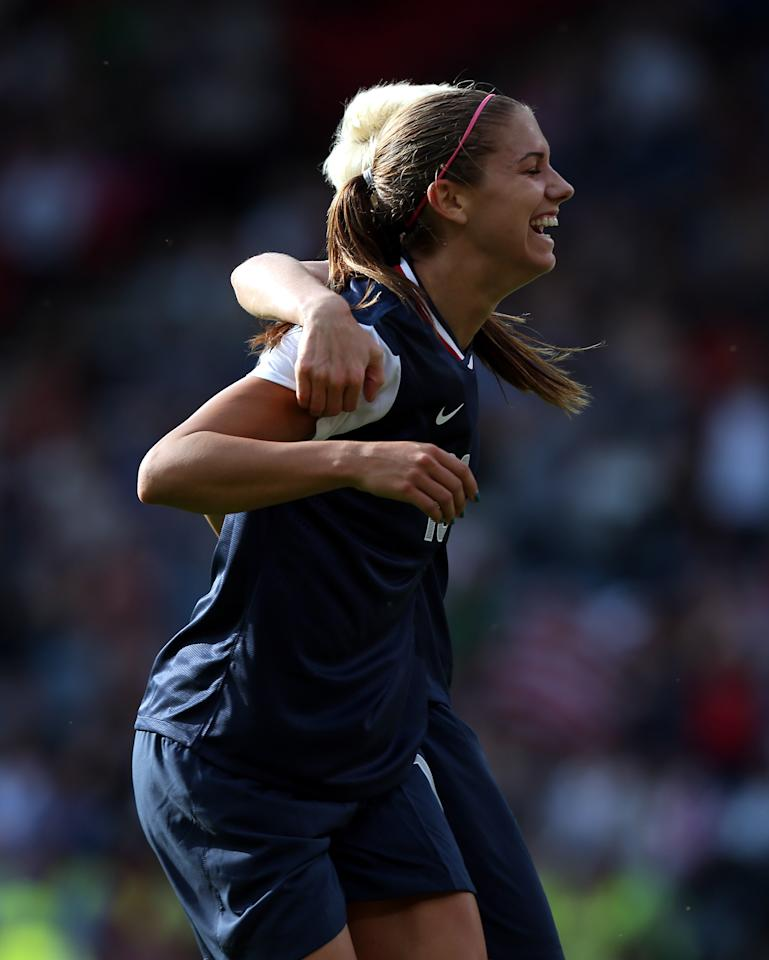 GLASGOW, SCOTLAND - JULY 25: Alex Morgan of USA reacts after scoring during the Women's Football first round Group G Match of the London 2012 Olympic Games between United States and France, at Hampden Park on July 25, 2012 in Glasgow, Scotland.  (Photo by Stanley Chou/Getty Images)