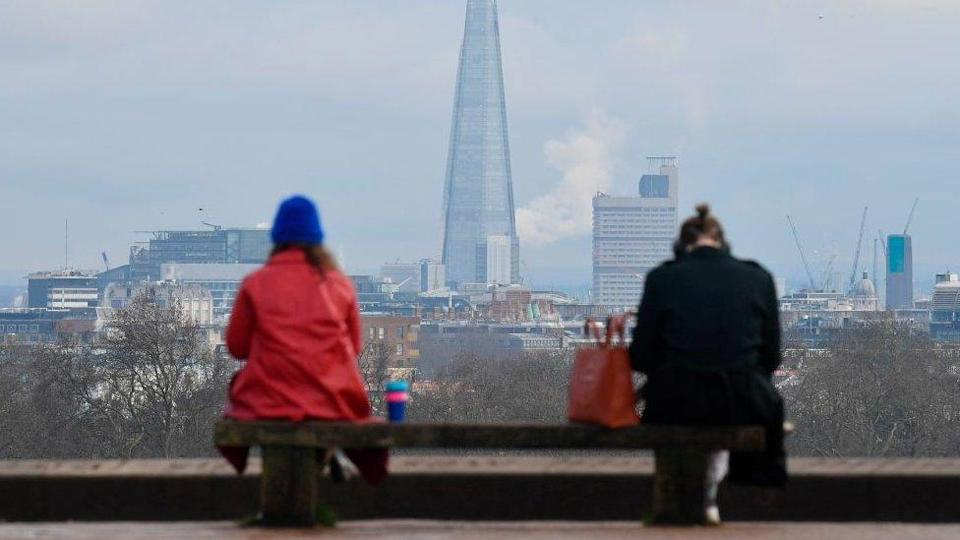 Two people social distancing in London
