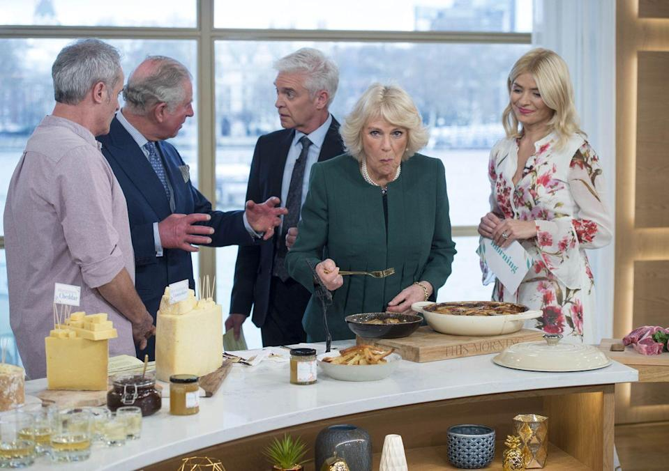 """<p>Busted! During a visit to ITV's program <em>This Morning </em>in January 2018, Camilla, looking very guilty, went for an extra forkful between shots while Charles visited with some of the show's anchors and chefs. In fairness to Camilla, those <a href=""""https://www.goodhousekeeping.com/holidays/thanksgiving-ideas/g297/easy-mashed-potatoes-recipes/"""" rel=""""nofollow noopener"""" target=""""_blank"""" data-ylk=""""slk:potatoes"""" class=""""link rapid-noclick-resp"""">potatoes</a>(?) do look <em>very</em> tasty, so we totally get why she'd want to have just one more bite.</p>"""