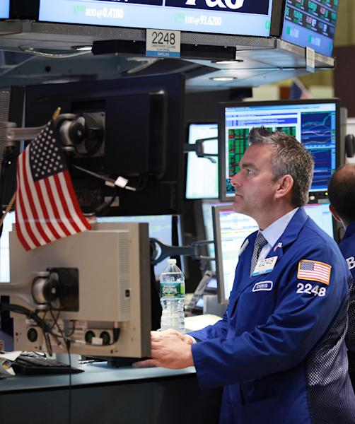 Specialist Christopher Culhane works the trading floor of the New York Stock Exchange. Thursday, Sept. 6, 2012. (AP Photo/David Karp)