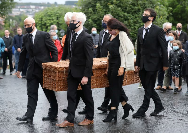 John Hume's coffin is carried into St Eugene's Cathedral in Londonderry
