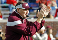 Mississippi State football coach Dan Mullen urges his team during warm-ups before an NCAA college football game against Mississippi in Oxford, Miss., Saturday, Nov. 29, 2014. (AP Photo/Rogelio V. Solis)
