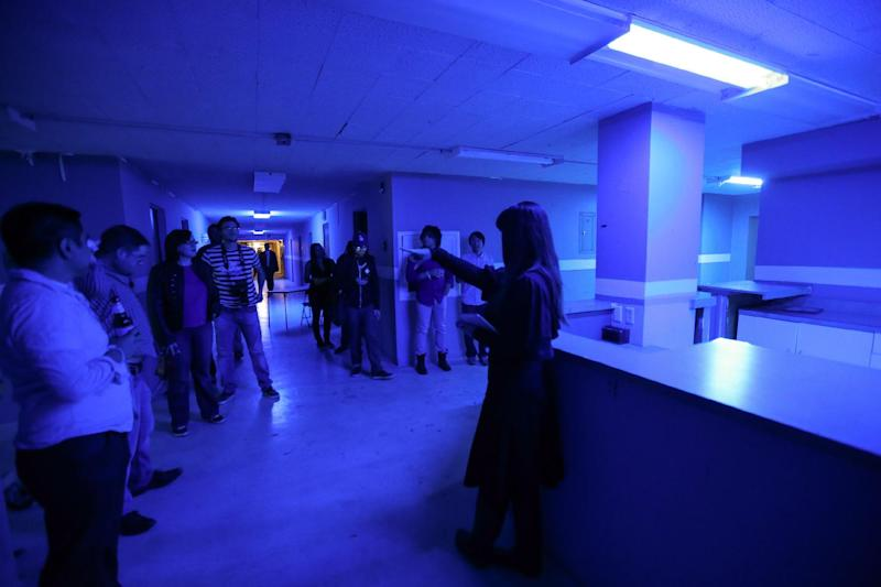 "People listen during a tour of Linda Vista Hospital at the ""American Horror Story: Asylum"" sleepover, on Monday, Oct. 7, 2013, in Los Angeles. (Photo by Paul A. Hebert/Invision/AP)"