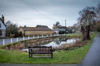 A village has been left bemused over rogue wildlife in the local pond following the mysterious appearance of an alligator. The miniature 'predator' has been floating in the water in Barton, Cambs., since just before Christmas, with its jaws gaping wide and its 'fierce' pointy teeth bared. But the tiny alligator certainly hasn't fazed the other wildlife that frequents the pond - and has become the talking point of the residents of Barton, which has a population of just 850 people.