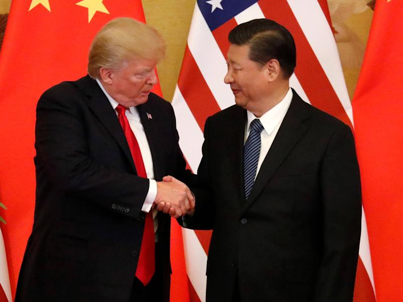 US President Donald Trump and China's President Xi Jinping make joint statements at the Great Hall of the People in Beijing: REUTERS