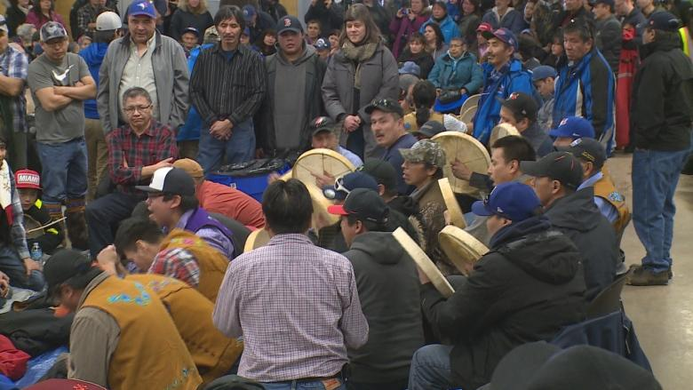 Catholic priest gives blessing at Behchoko's Dene handgames tournament