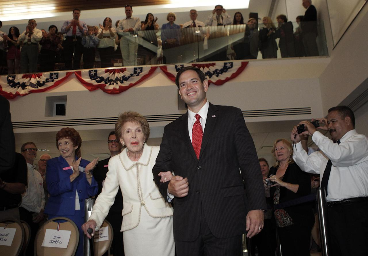 Former first lady Nancy Reagan, left, and Sen. Marco Rubio, R-Fla., arrive for the Reagan Forum at the Ronald Reagan Presidential Library in Simi Valley, Calif., Tuesday, Aug. 23, 2011. (AP Photo/Jae C. Hong)