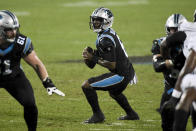 Carolina Panthers quarterback P.J. Walker looks to pass against the Atlanta Falcons during the second of an NFL football game Thursday, Oct. 29, 2020, in Charlotte, N.C. (AP Photo/Mike McCarn)