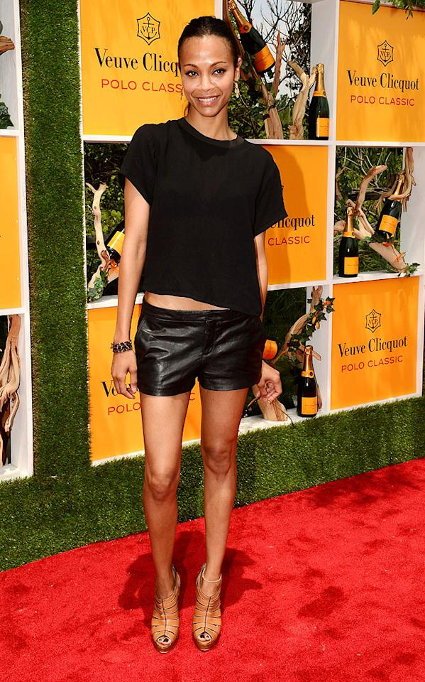 "Love the look of leather but don't wanna sweat to death for the sake of fashion? Try out a pair of buttery-soft shorts, like the Theyskens' Theory pair worn by Zoe Saldana at the fifth annual Veuve Clicquot Polo Classic. Rounding out the ""Avatar"" star's ensemble were a midriff-baring tee, Irene Neuwirth earrings, and tan Louboutin sandals. (6/2/2012)"