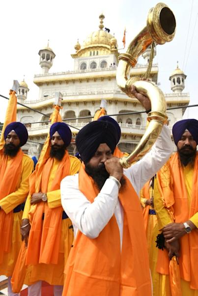 Sikhs around the world come together to sing, pray, eat and hold sprawling processions to mark Guru Nanak's birth (AFP Photo/NARINDER NANU)