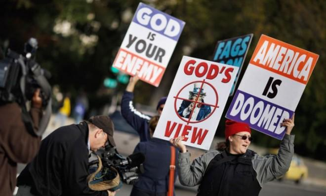 Members of the Westboro Baptist Church demonstrate outside the Supreme Court.