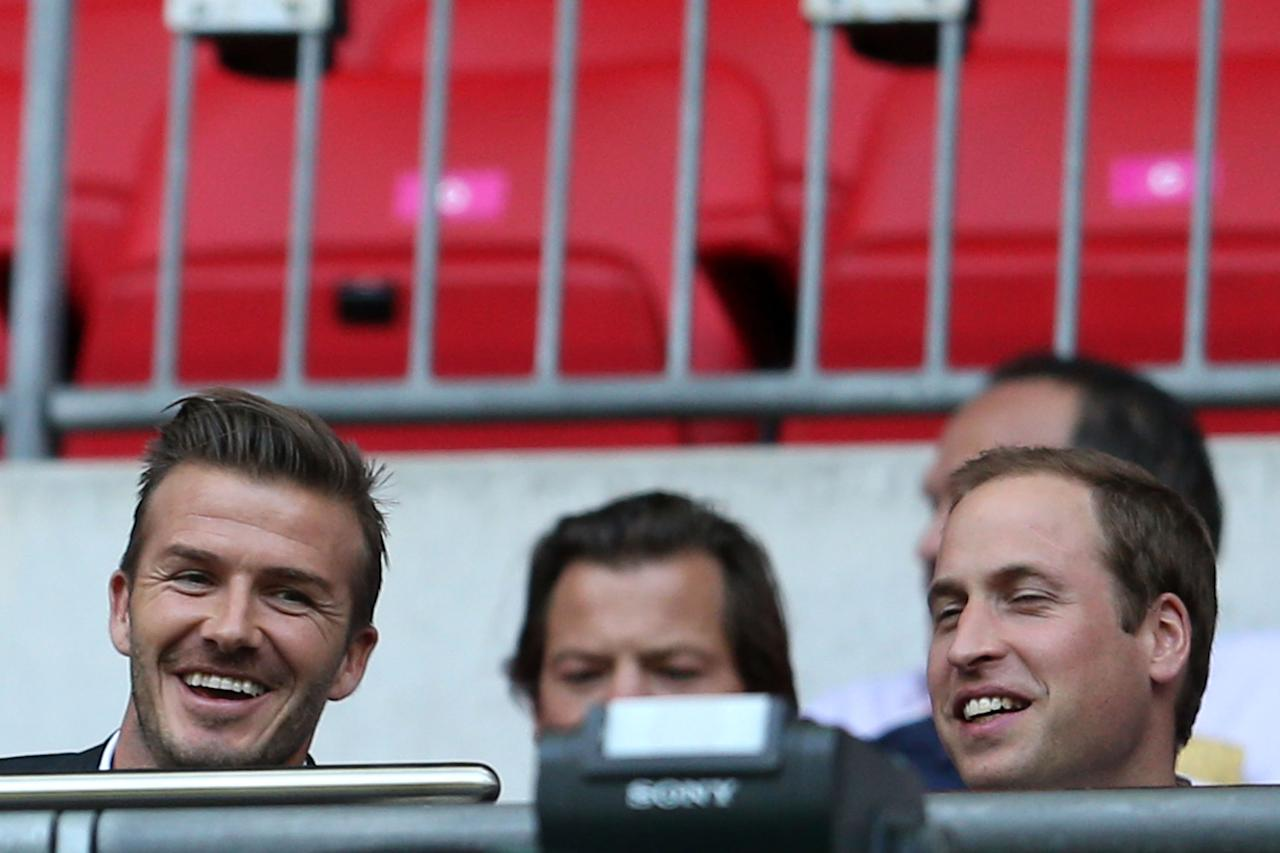 David Beckham and Prince William, Duke of Cambridge watch on during the Men's Football first round Group A Match between Great Britain and United Arab Emirates on Day 2 of the London 2012 Olympic Games at Wembley Stadium on July 29, 2012 in London, England.  (Photo by Julian Finney/Getty Images)