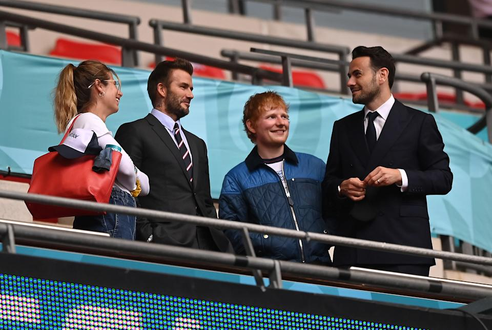 LONDON, ENGLAND - JUNE 29: (L-R) Cherry Seaborn, Wife of Ed Sheeran, David Beckham and Ed Sheeran are seen in the stands with a guest at half time during the UEFA Euro 2020 Championship Round of 16 match between England and Germany at Wembley Stadium on June 29, 2021 in London, England. (Photo by Shaun Botterill - UEFA/UEFA via Getty Images)