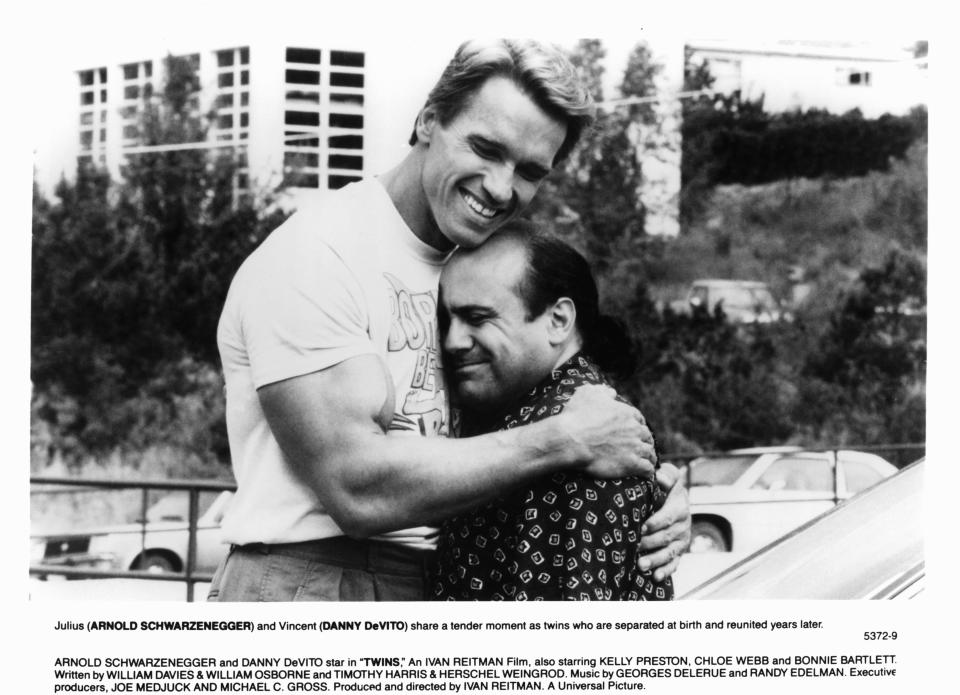 Arnold Schwarzenegger embracing Danny DeVito in a scene from the film 'Twins', 1988. (Photo by Universal/Getty Images)