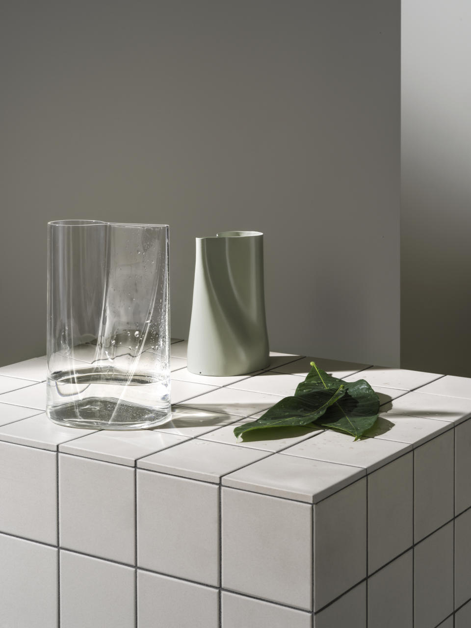CHILIFRUKT vase/watering can $19 (glass), $7 (green). Photo: IKEA (supplied).