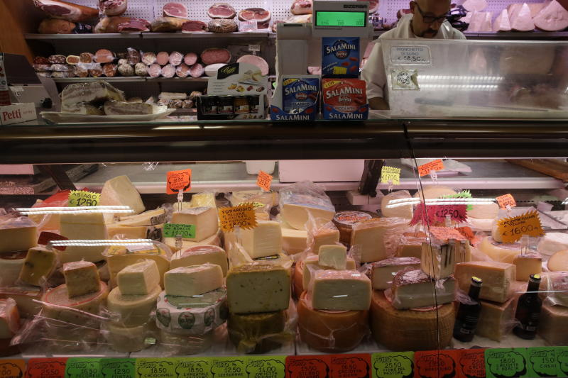 Blocks of Italian cheese are on sale in a deli in Rome, Thursday, Oct. 3, 2019. The U.S. had prepared for Wednesday's ruling and already drawn up lists of the dozens of goods it would put tariffs on. They include EU cheeses, olives, and whiskey, as well as planes, helicopters and aircraft parts in the case _ though the decision is likely to require fine-tuning of that list if the Trump administration agrees to go for the tariffs. (AP Photo/Alessandra Tarantino)