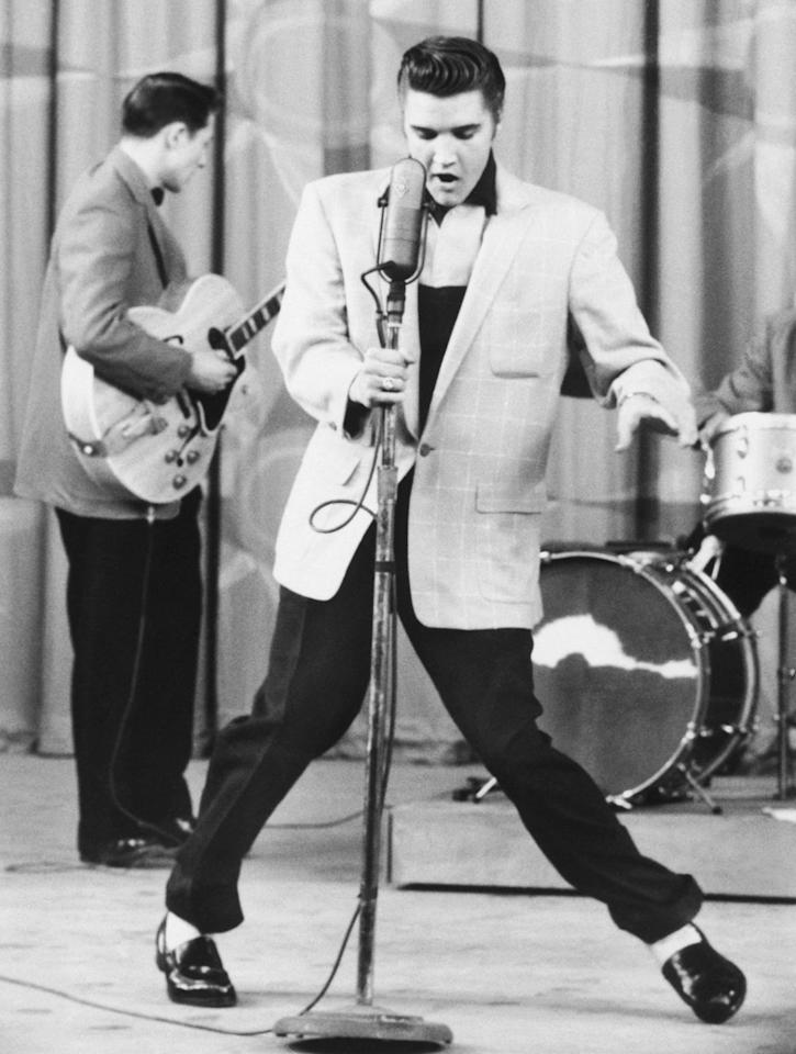 <p>The King dances with the mic during a June 22, 1956 performance in Hollywood, California.</p>