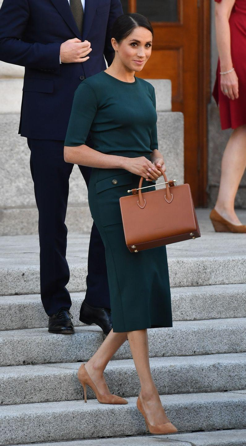 <p>Touching down in Dublin, the royal wore a forest green Givenchy blouse and skirt with tan heels, July 2018.</p>