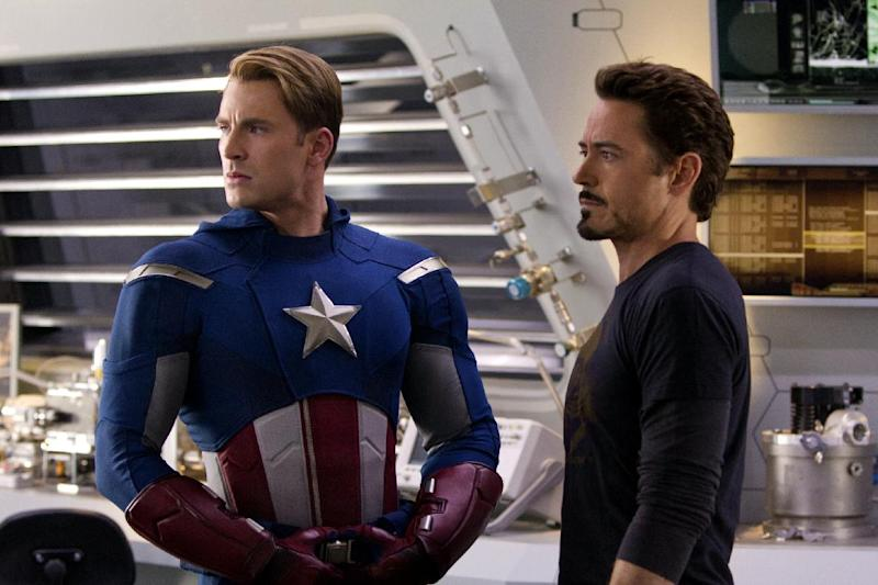 """In this film image released by Disney, Chris Evans, portraying Captain America, left, and Robert Downey Jr., portraying Tony Stark, are shown in a scene from """"Marvel's The Avengers"""" (AP Photo/Disney, Zade Rosethal)"""