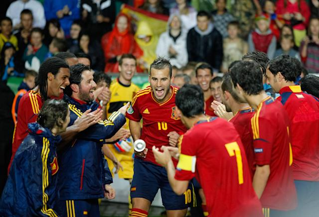 Spanish player Jese Rodriguez (C) celebrates with teammates after their 1-0 victory against Greece in the UEFA European Under-19 football championships final match between Spain and Greece, in Tallin, on July 15, 2012. AFP PHOTO / JAREK JOEPERAJarek Joepera/AFP/GettyImages