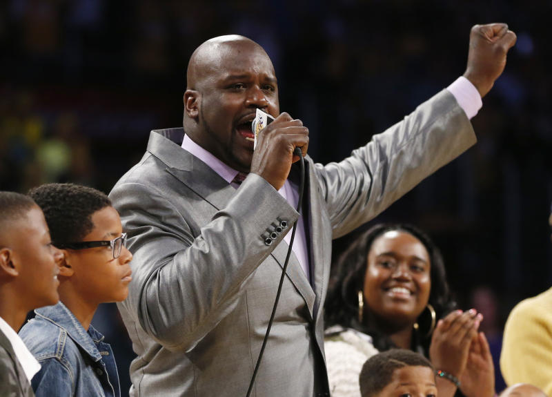 Former Los Angeles Lakers' Shaquille O'Neal gestures as he speaks during a ceremony to retire jersey #34 in honor of O'Neal during halftime of the NBA basketball game against the Dallas Mavericks in Los Angeles, April 2, 2013. REUTERS/Danny Moloshok (UNITED STATES - Tags: SPORT BASKETBALL)