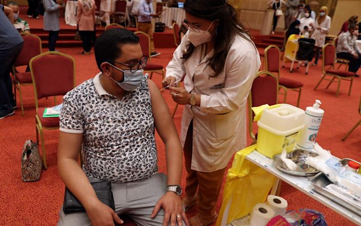 A Tunisian tourism industry worker receives a dose of the Pfizer-BioNTech vaccine in Tunis on June 4 2021 - Mohamed Messara/Shutterstock