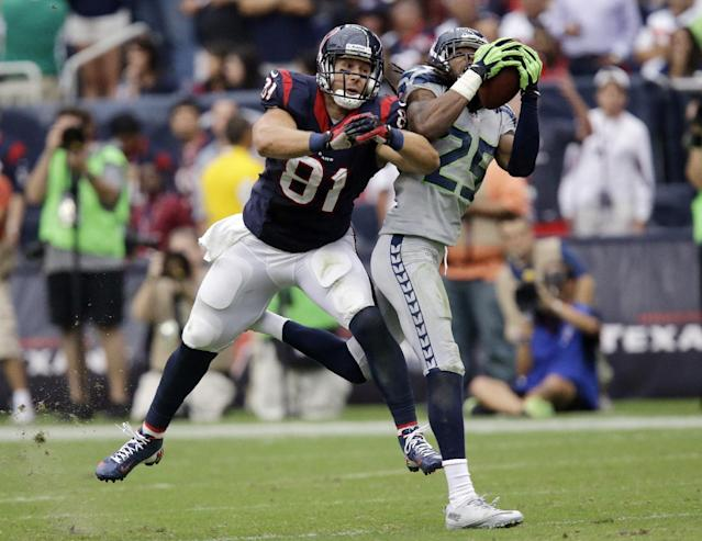 Seattle Seahawks' Richard Sherman (25) intercepts the ball in front of Houston Texans' Owen Daniels (81) during the fourth quarter an NFL football game on Sunday, Sept. 29, 2013, in Houston. Sherman returned the ball for a touchdown. (AP Photo/Patric Schneider)