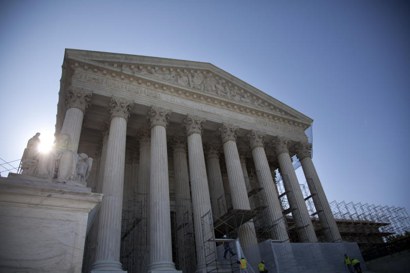 A view of the Supreme Court in Washington, Wednesday, June 27, 2012. Saving its biggest case for last, the Supreme Court is expected to announce its verdict Thursday on President Barack Obama's health care law. The outcome is likely to be a factor in the presidential campaign and help define John Roberts' legacy as chief justice. But the court's ruling almost certainly will not be the last word on America's tangled efforts to address health care woes. (AP Photo/Evan Vucci)