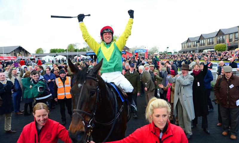 Sizing John and his jockey Robert Power are led into the winners enclosure following their stunning win in Punchestown Gold Cup.