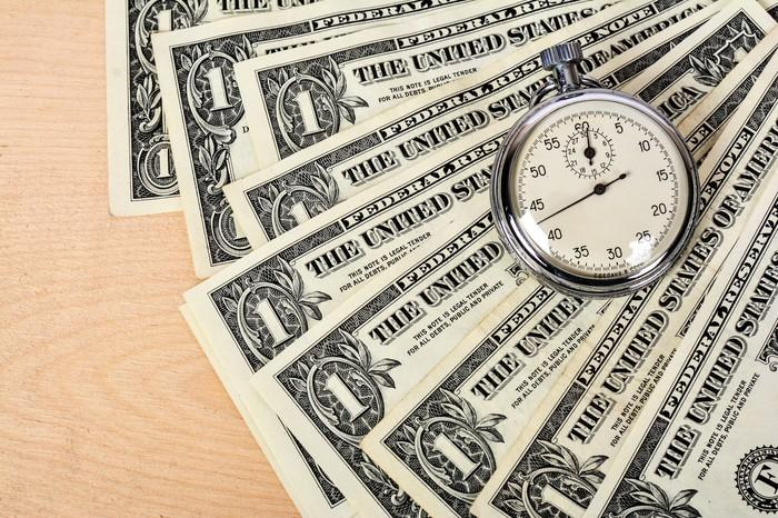 Pile of cash with a stopwatch