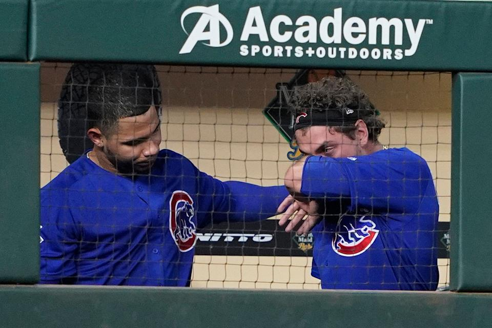 Chicago Cubs' Albert Almora Jr., right, is wipes away tears he Willson Contreras, left, left, consoles him after checking on a young child which was struck by his foul ball during the fourth inning of a baseball game against the Houston Astros Wednesday, May 29, 2019, in Houston. (AP Photo/David J. Phillip)
