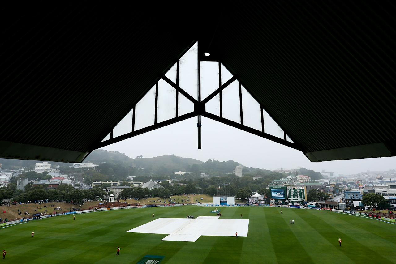 WELLINGTON, NEW ZEALAND - MARCH 17:  Covers are placed on the wicket as rain delays play during day four of the second Test match between New Zealand and England at Basin Reserve on March 17, 2013 in Wellington, New Zealand.  (Photo by Hagen Hopkins/Getty Images)
