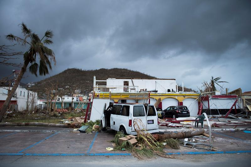 A picture shows a wrecked car in the streets of Marigot, on Sept. 9 in St. Martin island devastated by Irma hurricane. (MARTIN BUREAU via Getty Images)