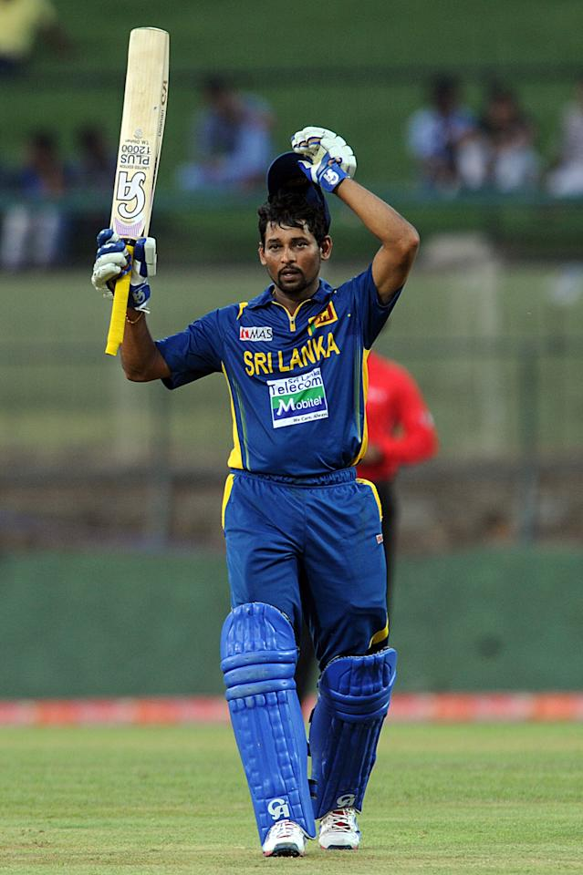 Sri Lankan cricketer Tillakaratne Dilshan raises his bat to the crowd after scoring a century (100 runs) during the third and final one-day international (ODI) match between Sri Lanka and Bangladesh at The  Pallekele International Cricket Stadium in Pallekele on March 28, 2013. AFP PHOTO/ Ishara S. KODIKARA        (Photo credit should read Ishara S.KODIKARA/AFP/Getty Images)