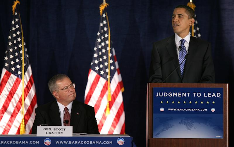 FILE - In this Tuesday, Dec. 18, 2007 file photo, then Democratic presidential hopeful, Sen. Barack Obama, D-Ill., right, speaks prior to a foreign policy forum as then retired Air Force Gen. Scott Gration, left, looks on in Des Moines, Iowa. The U.S. ambassador to Kenya Scott Gration said Friday, June 29, 2012 that he is leaving his post over differences with Washington on his leadership style, adding that he resigned Monday, June 25, 2012, effective Saturday, July 28, 2012. (AP Photo/Kevin Sanders, File)
