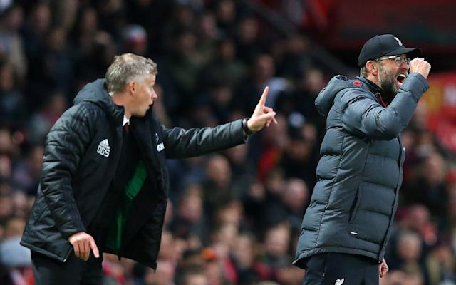 Ole Gunnar Solskjaer, Manager of Manchester United and Jurgen Klopp, Manager of Liverpool gives their side instructions - Getty Images Europe